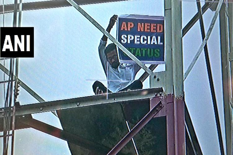 Man climbs cell tower in Delhi demands Special Status for AP
