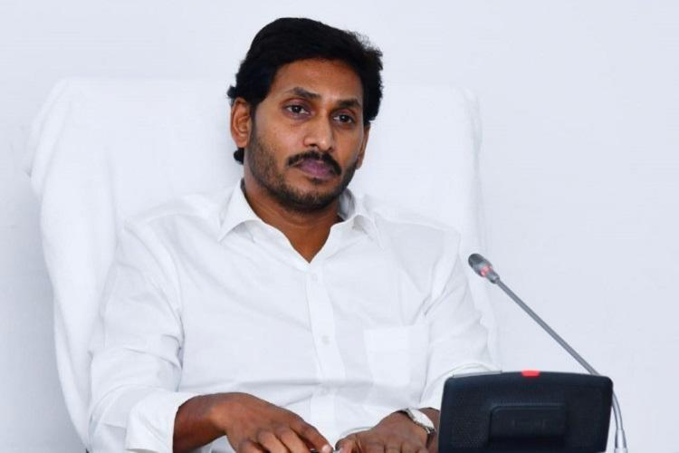 Photo of CM Jagan Mohan Reddy sitting on a white chair