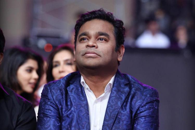 AR Rahman at a Filmfare Awards event Wearing a blue coat looking up