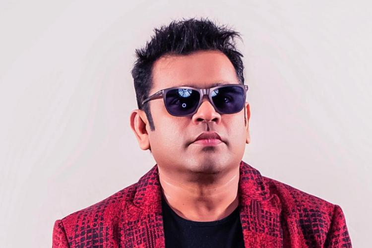 AR Rahman wearing red blazer black shades