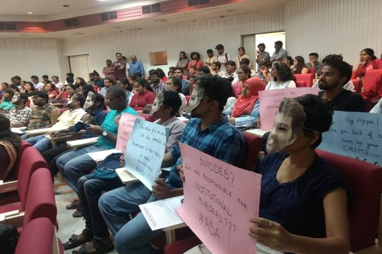 Donning masks of Rohith Vemula ASA students protest against UoH VC