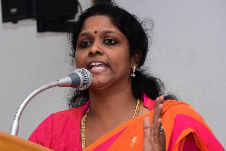 ASP Jansirani speaking at an event wearing orange saree