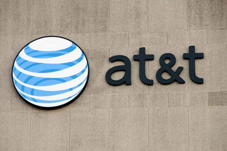 Board saying att with a blue and white sphere logo