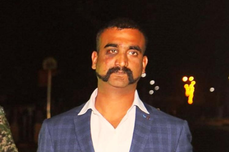 File photo of Wg Cdr Abhinandan in a blue suit, looking at the camera
