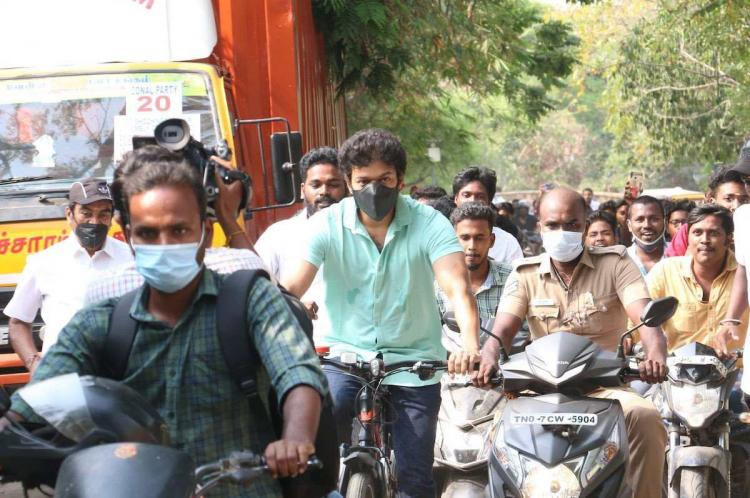 Actor Vijay seen wearing a green t-shirt and mask riding a red and black cycle to vote in Tamil Nadu elections 2021