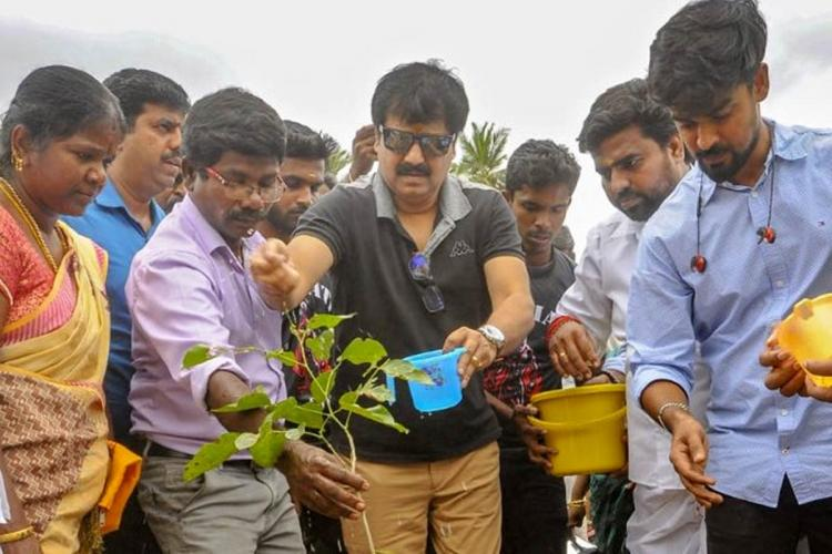 Vivek is seen planting saplings along with students