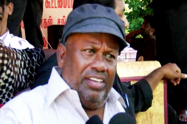 Veteran actor Senthil is seen wearing a white shirt and blue cap in the image