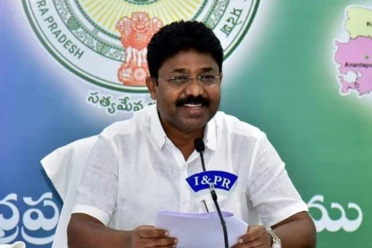 Education Minister Adimalupu Suresh in a white shirt addressing the media