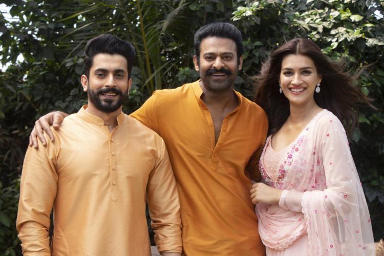 Prabhas is seen in orange kurta alongwith Sunny and Kriti