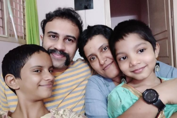 Family photo of Karthik with his daughters and wife