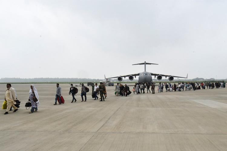 People who were stranded in crisis-hit Afghanistan arrive by a special repatriation flight of IAF