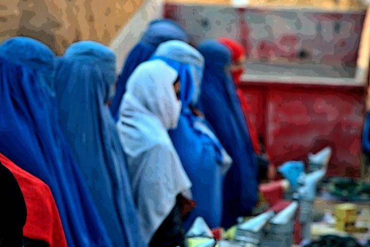 Women in blue burkhas standing in a queue