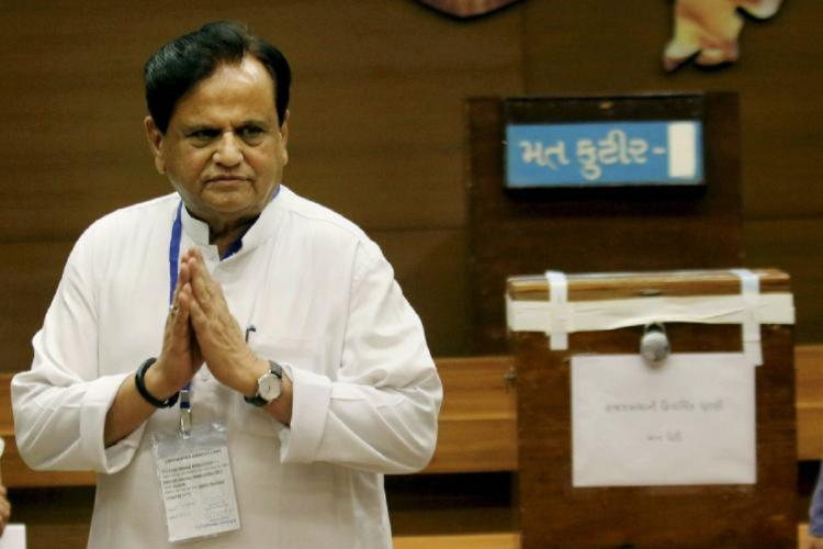 A file photo of Ahmed Patel with folded arms at an event