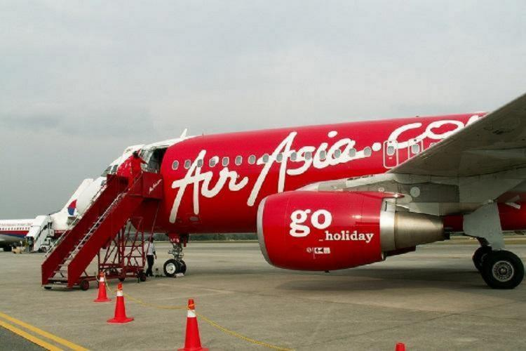 Air asia flight standing at airport runway