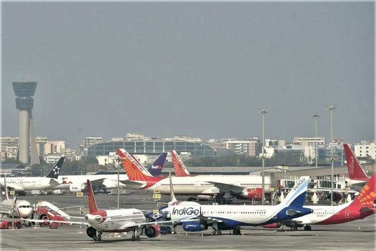 Different aircraft of airlines parked at the airport