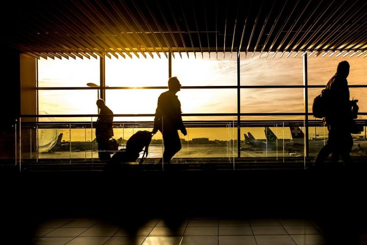 A silhouette of a man walking in an airport