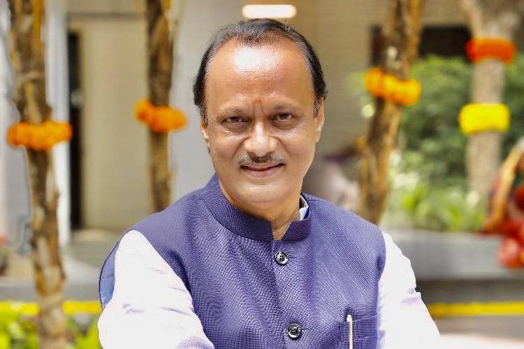 Maharashtra Deputy CM Ajit Pawar wears a white and blue outfit with a pen in his pocket