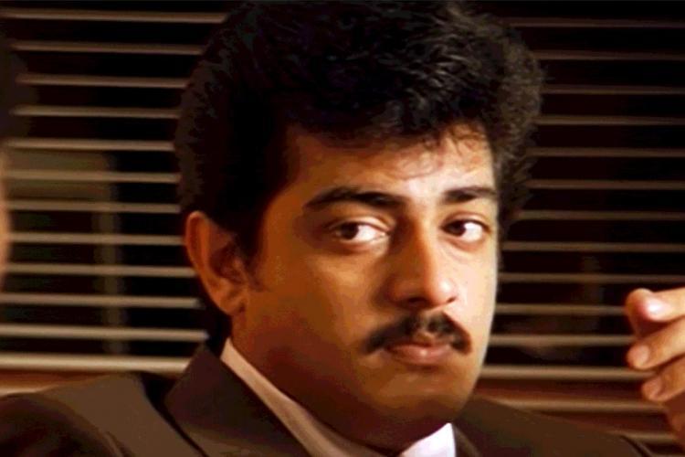 Ajith is seen wearing a brown coat in a screengrab from Tamil movie Vaalee