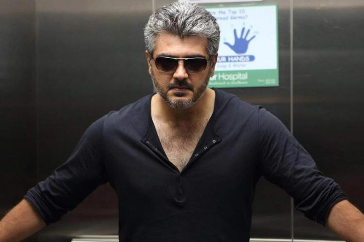 Ajith Kumar is seen sporting a stylish look in a grey t-shirt and sun glasses with the salt and pepper hairdo