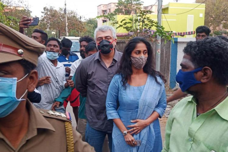 Actors Ajith and Shalini seen at a polling booth in Thiruvanmiyur