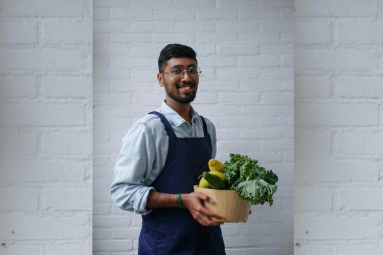 Akash Muralidharan holding a basket of vegetables