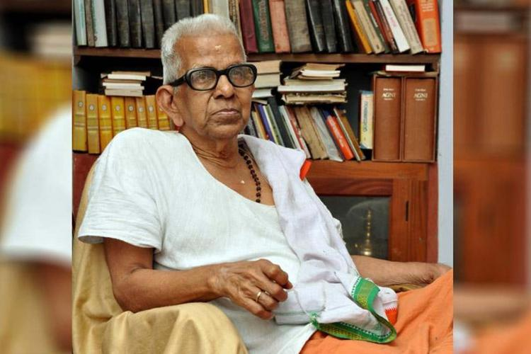 Akkitham Achuthan Namboothiri sitting on a chair in his room