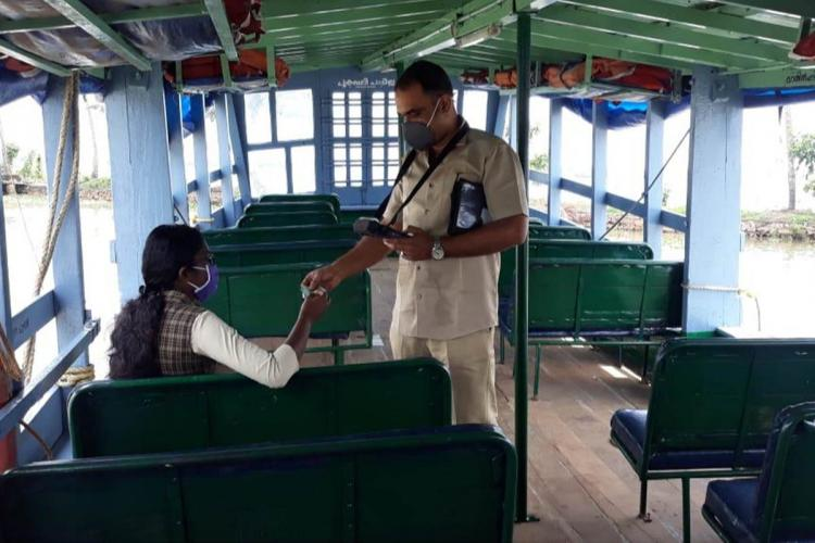The class 11 student and boat operator in the Kerala State Water Transport Department boat from Alappuzha