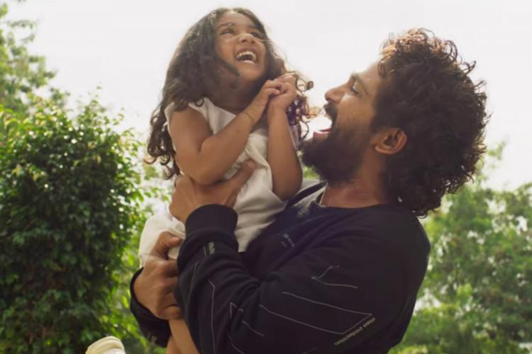 Allu Arjun holding up his daughter Arha both of them are laughing