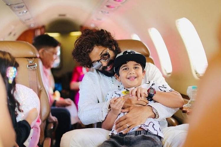 Allu Arjun with his son Ayaan and his family sitting in a flight
