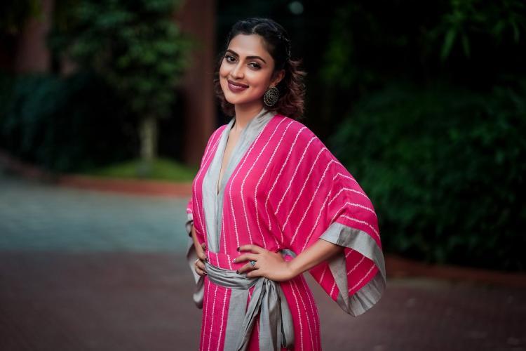 Amala Paul in a bright pink kimono dress