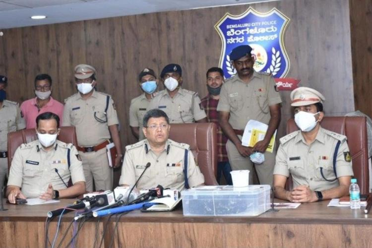 Commissioner of Bengaluru Police KG Halli team and four accused during a press interaction after the arrest