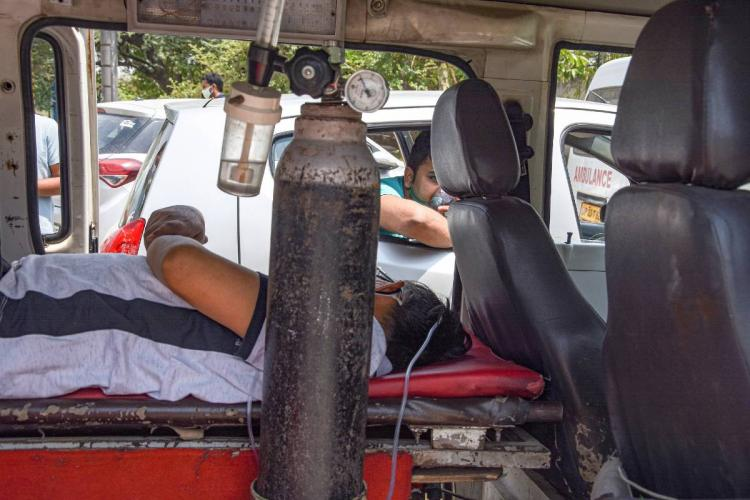 A COVID patient receiving primary treatment outside a hospital amid shortage of beds and medical oxygen