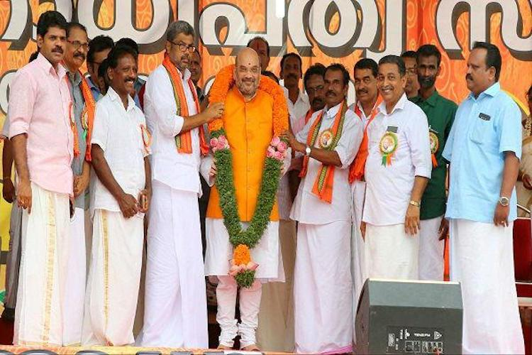 BJP chief Amit Shah arrives in Kerala, given a rousing welcome