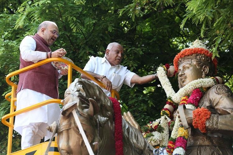 Basaveshwara Jayanti Amid protests in Bluru Amit Shah garlands Basavanna statue
