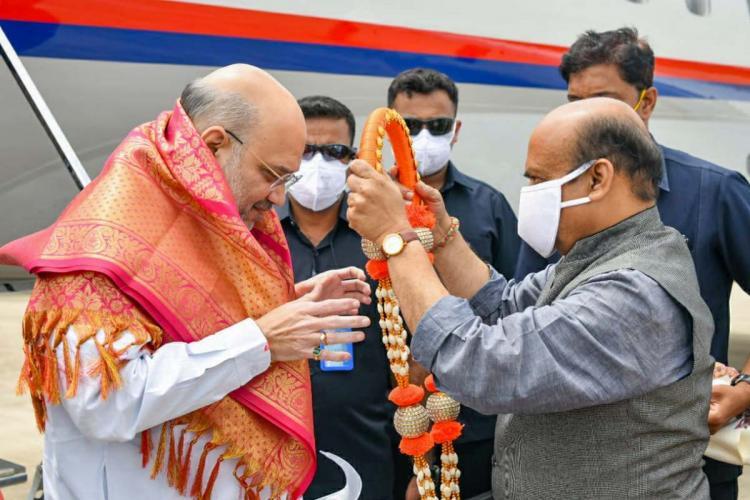 Karnataka CM Basavaraj Bommai garlanding Union Home Minister Amit Shah