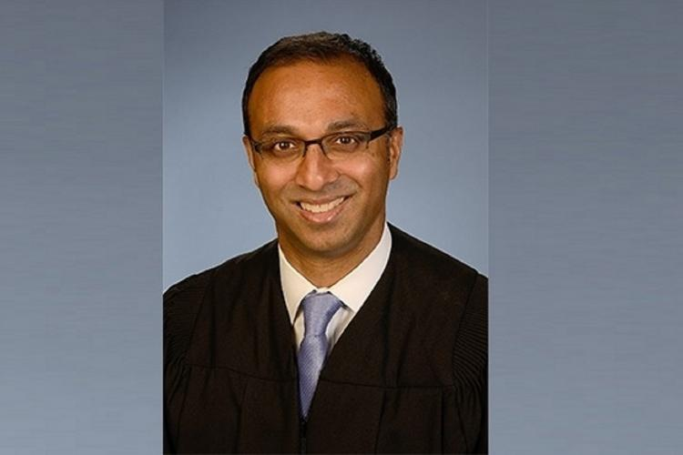Portrati of US judge Amit Mehta wearing a suit and blue tie