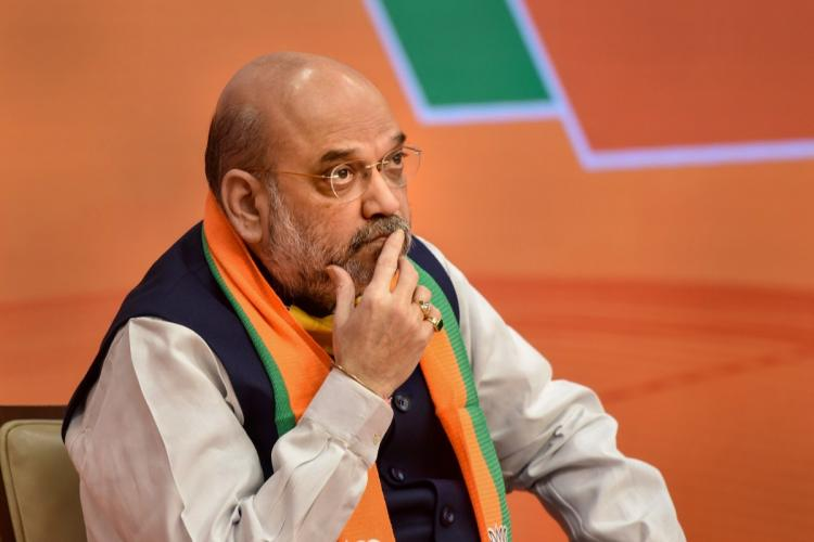 File photo of Amit Shah where he is seen in a deep state of thinking with a finger on his lips