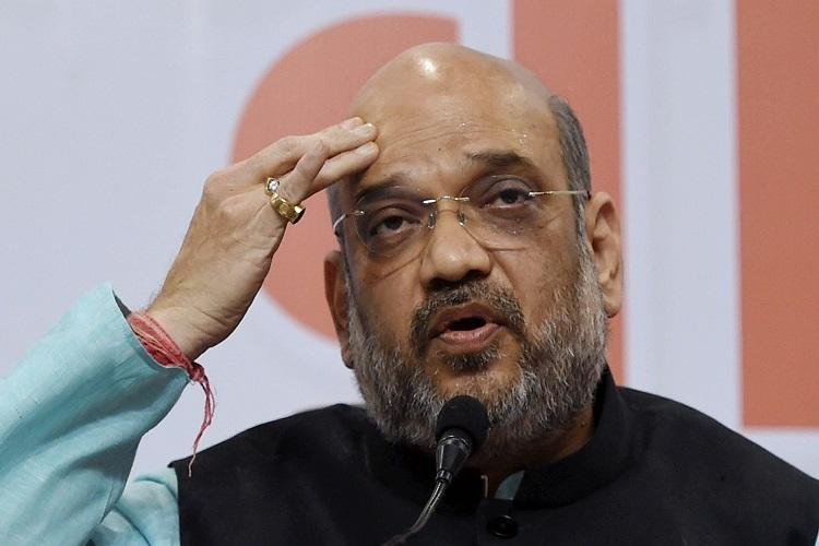 Amit Shah to meet Karnatakas Adichunchanagiri pontiff seen as a move to lure Vokkaligas