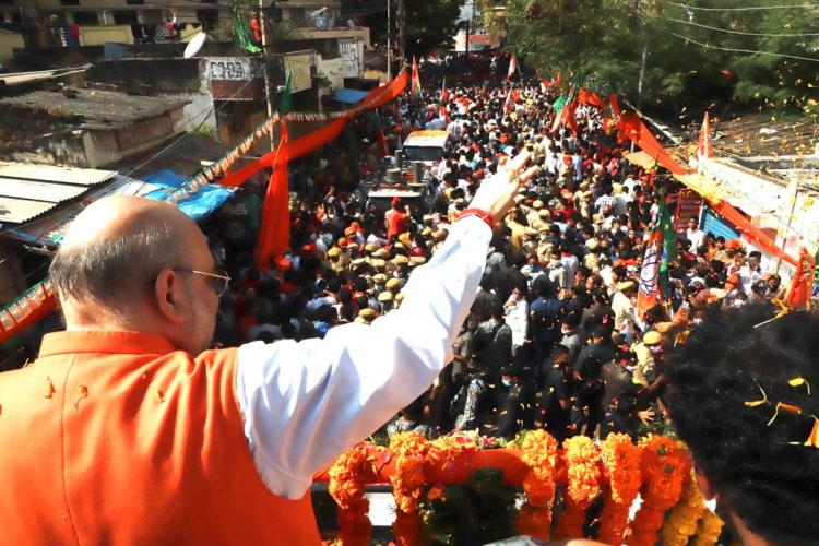 Amith Shah at a road rally in Hyderabad ahead of municipal elections