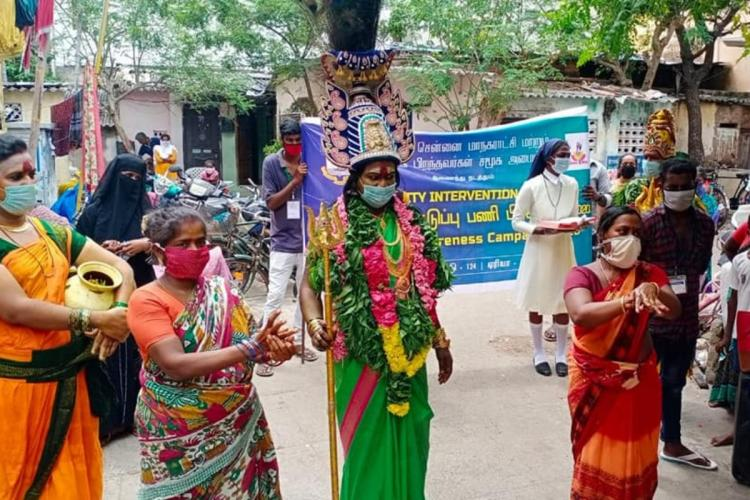 A transwoman dressed up as Goddess Amman enacting a skit in Chennai