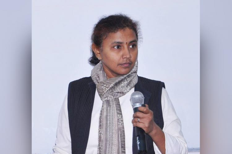 IAS officer P Amudha who has now been appointed in the PMOs office in News Delhi holding a microphone