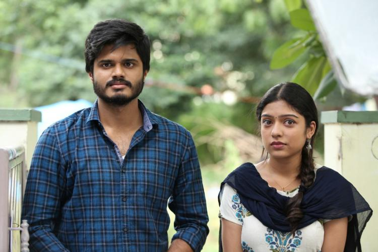 Anand Devarakonda and Varsha Bollamma looking a bit scared in a still from Middle Class Melodies