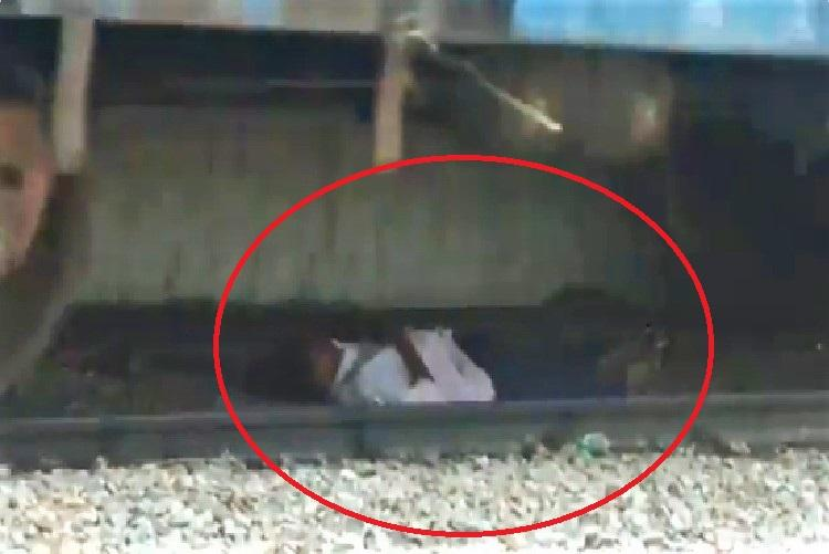 Video Andhra man caught under moving train has a miraculous escape