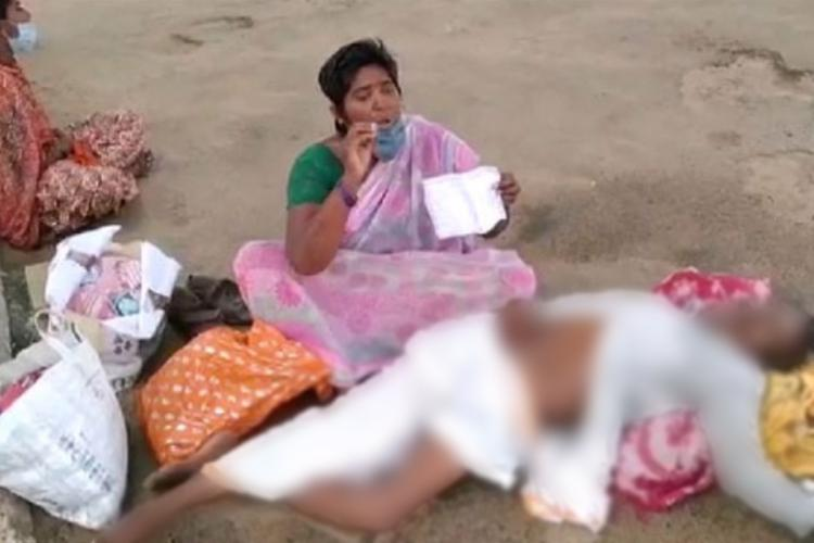 A woman wailing beside her dead husband at Anantapur Government Hospital