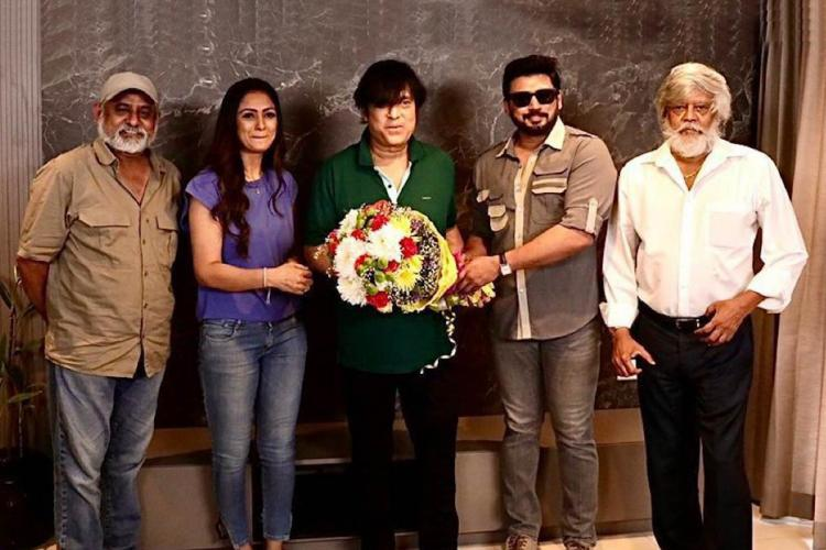 Actors Prashanth and Simran are seen alongside Karthik in the image
