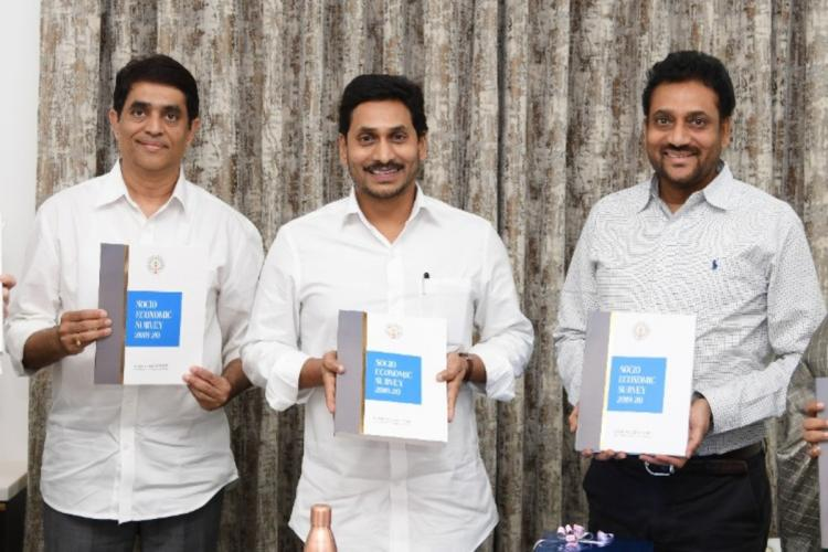 Andhra Pradesh Chief Minister and Finance Minister holding the Socio Economic Survey