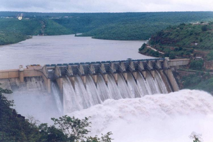 Water flowing out of dam gates with force