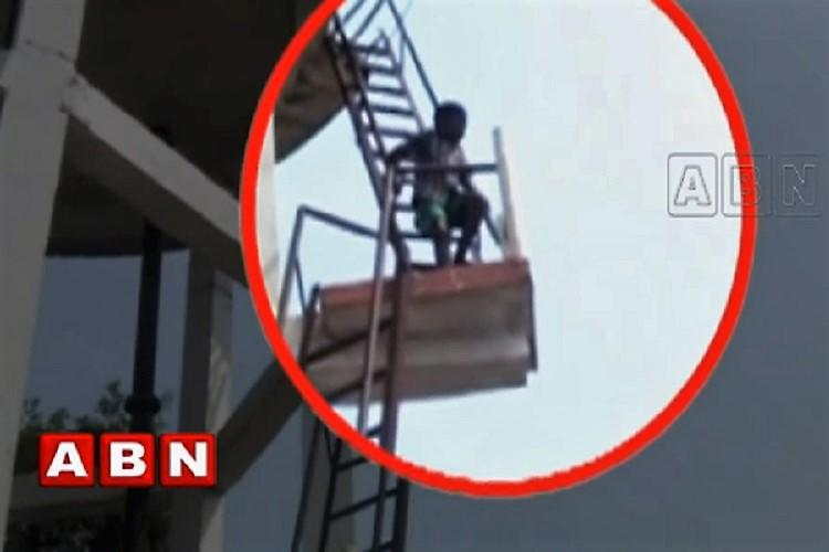 Video Class 3 student in Andhra threatens to jump off water tank to avoid school
