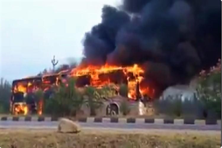Video Passenger bus catches fire on Andhra highway passengers escape unhurt