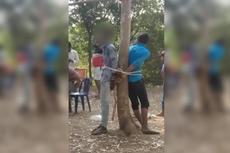 The victims being tied to a tree